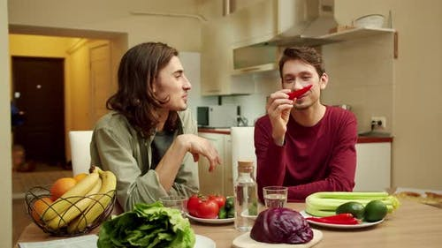 Two Men are Talking About Vegetables and Smiling