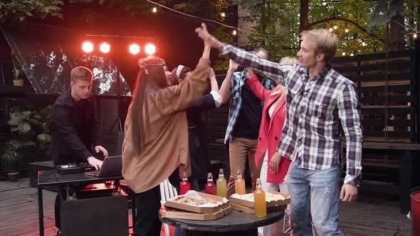 Joyful Young Caucasian Friends Giving High Five, Together Celebrating on Party