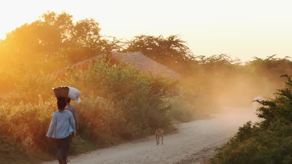Thumbnail for Women walking on countryside road