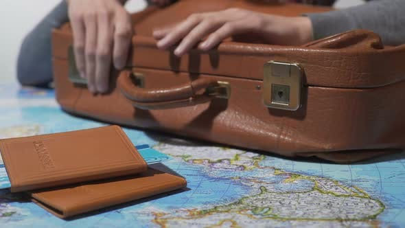 Cover Image for Man Ready for Trip With Packed Suitcase and Tickets, Dreaming About Vacation