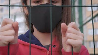 Upset Teen in Mask
