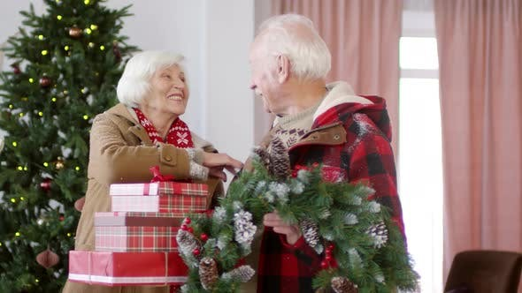 Thumbnail for Happy Elderly Couple Posing with Christmas Presents