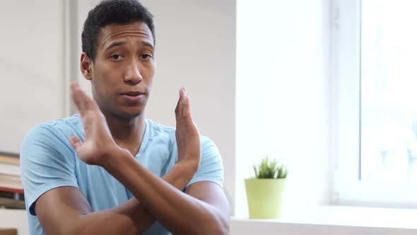 Cover Image for Rejecting, Gesture of No by Young Black Man