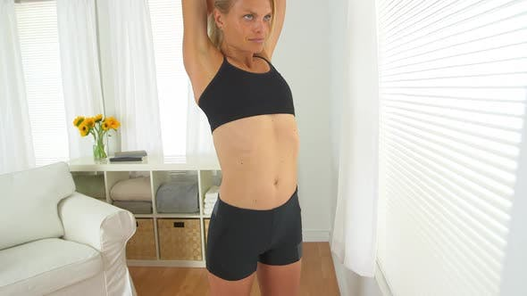 Thumbnail for healthy woman stretching arms before workout