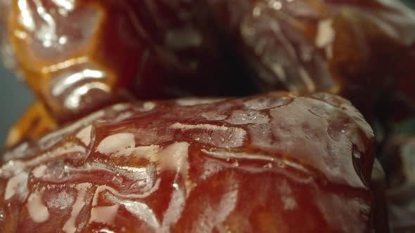 Macro of wrinkled skin on dates