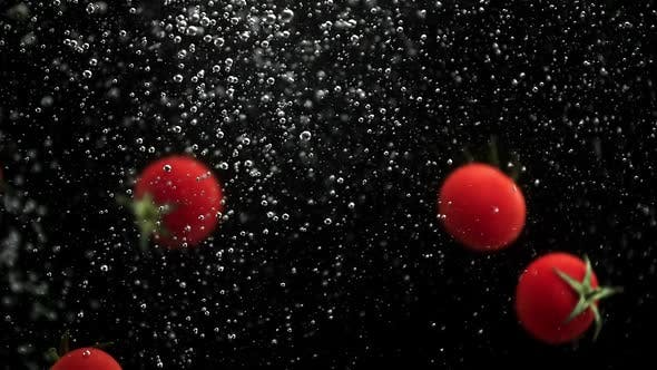 Thumbnail for Cherry Tomatoes and Red Yellow Paprika Bell Peppers Falling Into Water with Air Bubbles