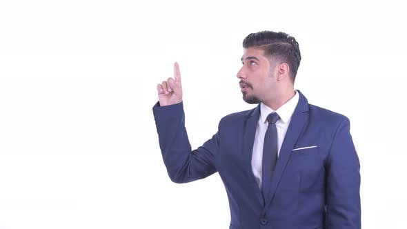 Thumbnail for Happy Bearded Persian Businessman Talking While Pointing Up