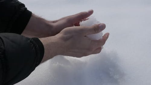 Snowball made for playing and fighting 4K 2160p 30fps UHD footage - Wet snow shaping by hands 3840X2