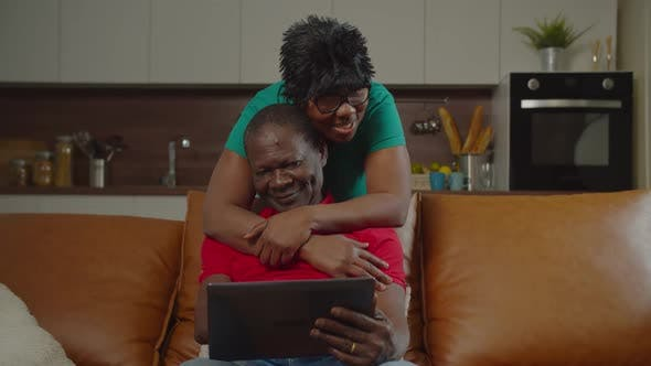Thumbnail for Loving Retired African Couple Hugging at Home