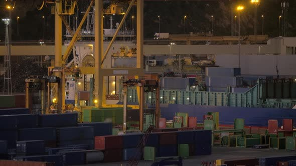 Container port with working crane and vehicles