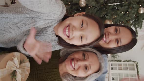 Thumbnail for Cheerful Asian Family Wishing Merry Christmas on Video Call