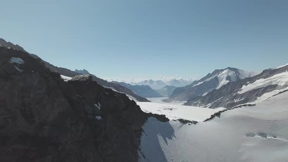 Thumbnail for View From Above Majestic View of Snow Capped Mountains and People Hiking