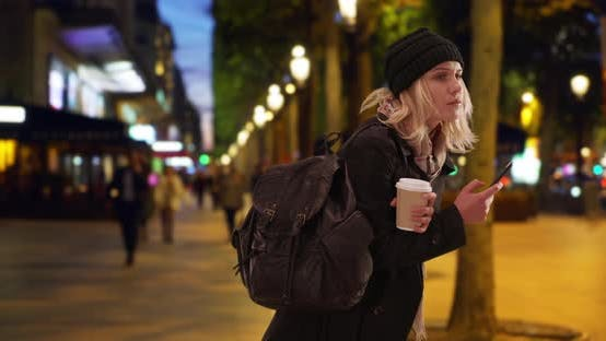 Thumbnail for Confused blonde female tourist in Paris navigating location at Champs-Elysees