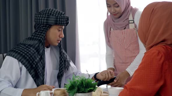 Thumbnail for Asian Muslim Man Using Smartwatch Payment