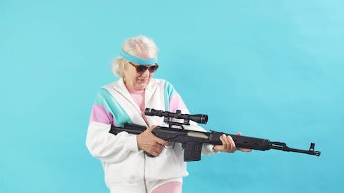 Nice Looking Grandmother- FBI Agent Aiming with a Rifle, Ready To Shoot, Poster.