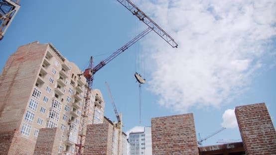 Thumbnail for Crane at Building Construction Site, Architecture Apartments. Wide Shot V6