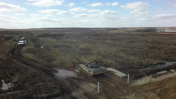 Aerial view of tank firing at military training area, Russia