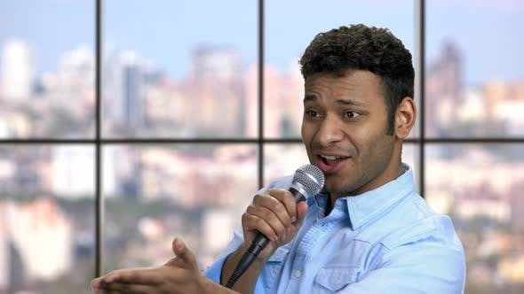 Charismatic Entertainer Talking Into Microphone
