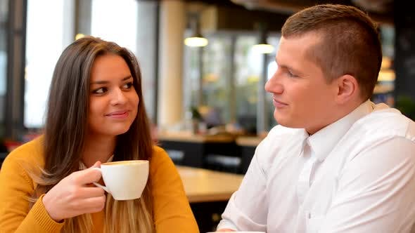 Thumbnail for Happy Couple Drink Coffee and Smiles in Cafe, To Camera, Closeup