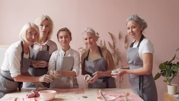Thumbnail for Female Ceramists Team in Pottery Workshop