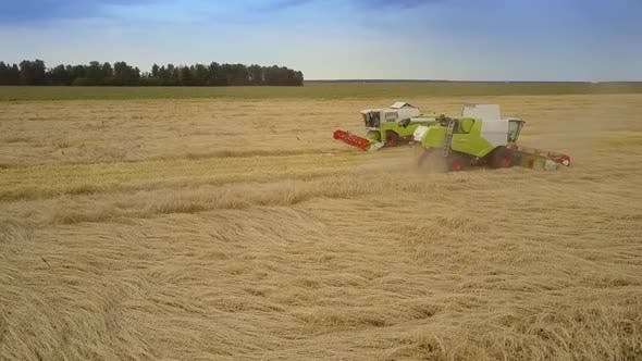 Thumbnail for Aerial Motion To Harvester Operating in Wheat Field