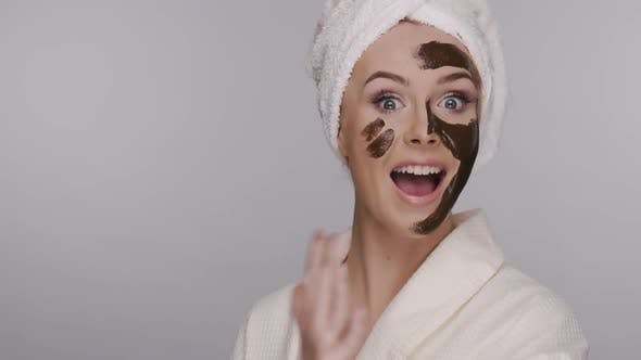 Thumbnail for Beautiful Girl Smiling and Applying Face Mask in Head Towel