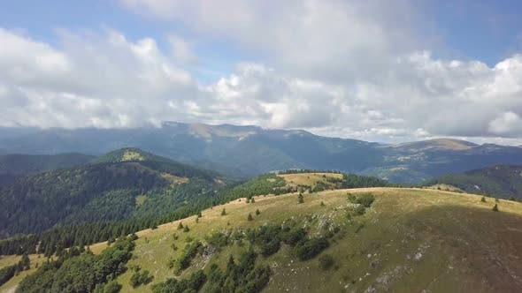 Fly Above Green Carpathian Mountains Landscape in Sunny Summer