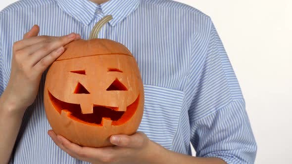Thumbnail for Woman Petting Halloween Pumpkin Isolated on White 1080p