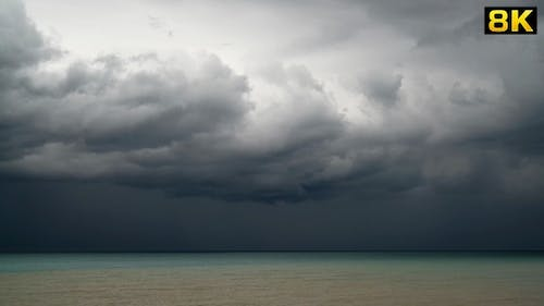 Storm Clouds and Rain at the Sea