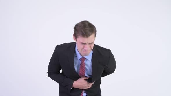 Thumbnail for Young Stressed Businessman Having Stomach Ache