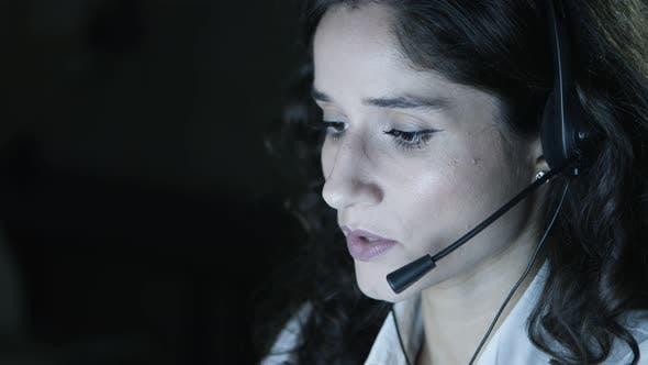 Thumbnail for Businesswoman in Headset Talking in Dark Office