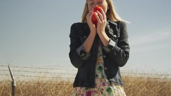 Thumbnail for Young woman holding fresh picked vegetables