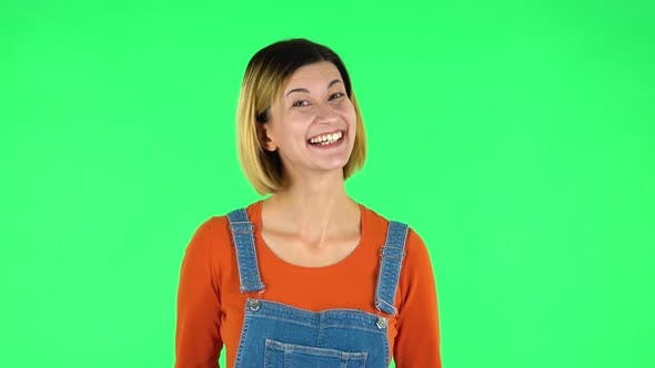 Cover Image for Lovely Girl Smiles Broadly and Winks. Green Screen