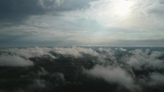 Through The Clouds You Can See The Green Fields From A Bird's Eye View. Agroindustry Ukraine Rivne