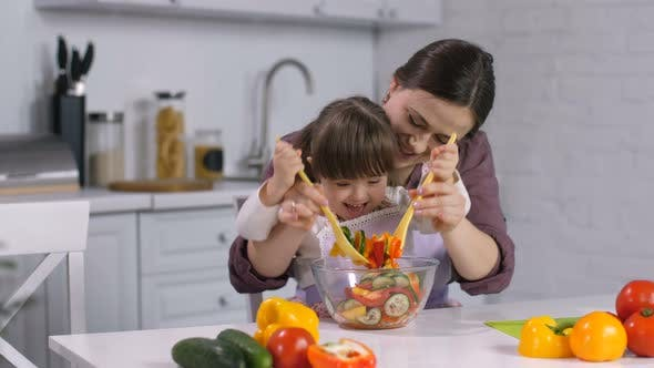 Thumbnail for Family with Special Needs Child Cooking in Kitchen