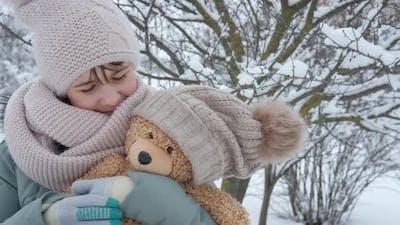 Hugs Teddy Bear in Winter
