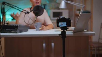 Influencer Sitting at Vlog Station