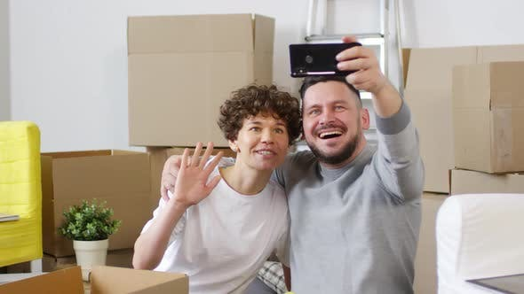 Thumbnail for Cheerful Middle-Aged Caucasian Couple Taking Selfies in New Home