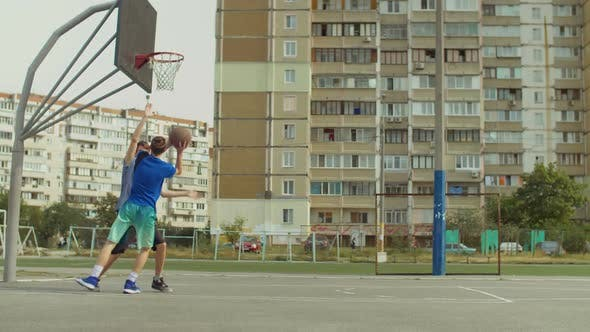 Thumbnail for Streetball Player Scoring Field Goal on Court