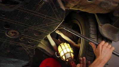 Close Up Shot of Car Suspension Service in Maintenance Car Garage