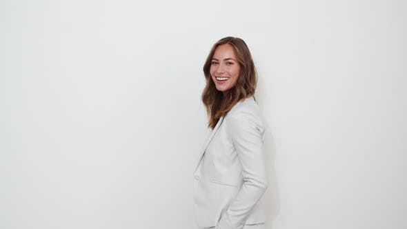 Thumbnail for Businesswoman Smiling in White Suit