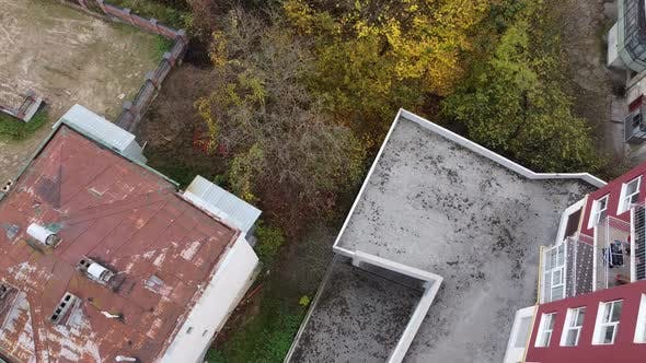 Thumbnail for Aerial view of a drone flying over the residential buildings, roof shooting and architecture.