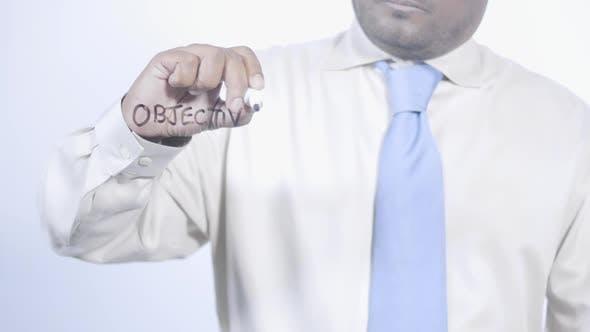 Latino Businessman Writes Objectives