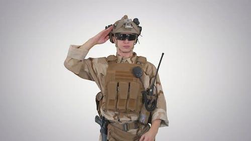 Soldier Ranger in Ammunition Saluting on Gradient Background.