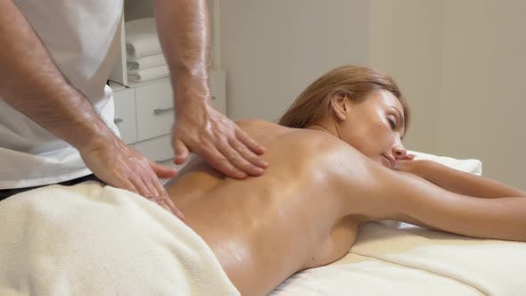 Thumbnail for Beautiful Sexy Woman Relaxing at Spa Getting Full Body Massage