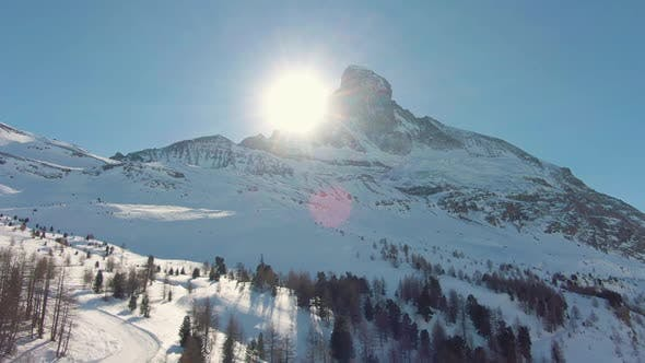 Thumbnail for Matterhorn Mountain and Sun in Winter. Northern Wall. Swiss Alps. Switzerland. Aerial View
