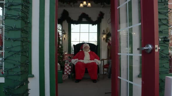 Thumbnail for View of Santa sitting in holiday booth