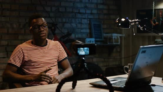 Thumbnail for Young Man Talking on Camera in a Garage