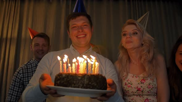 Thumbnail for Happy Guy with Friends Bringing Birthday Cake To You.