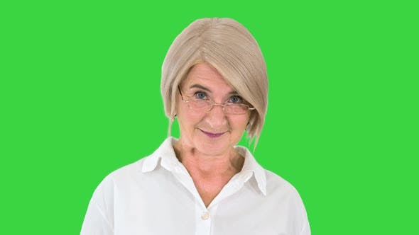 Thumbnail for Grandmother in Glasses and with Gray Hair Happy and Smiling Looking To Camera on a Green Screen